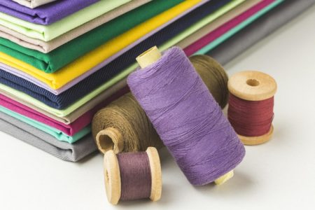 stack-fabric-with-spools-thread_23-2148739441